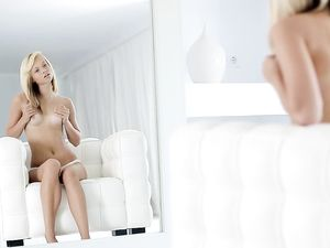 Teen Stares Into The Mirror As She Rubs Her Cunt
