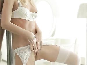 Teenager Clad In Sexy White Lingerie Masturbates
