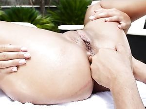 Oiled Up Blonde Gets Her Booty Filled Outdoors